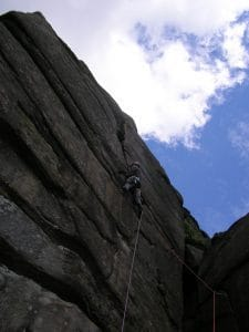 Pete leading Tower Face VS, Stanage plantation.